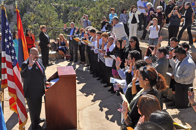 On Thursday, September 23, 2010, Grand Canyon National Park in coordination with The Department of Homeland Security, hosted a naturalization ceremony at the Mather Amphitheatre on the South Rim. This is the first time in history that Grand Canyon National Park has hosted such an event. Under blue skies and before a breathtaking view, 23 individuals from 12 different countries including, Colombia, Dominican Republic, Guatemala, Japan, Mexico, Morocco, Australia, Trinidad and Tobago, Uruguay, Venezuela, Vietnam and Zambia, became naturalized citizens. Many family members and close friends of the candidates came to show their support for this special event. Park employees and visitors also watched on as the candidates stated the Oath of Allegiance, and received their certificates of naturalization.  This event is part of USCIS's annual celebration of Constitution Day and Citizenship Day. An estimated 9,258 candidates became citizens at 63 special ceremonies held across the country and around the world from September 13-24, 2010. Constitution Day is celebrated on Sept. 17 in remembrance of the signing of the Constitution in 1787. Since 1952, Citizenship Day has been celebrated in conjunction with Constitution Day. NPS Photo by Michael Quinn